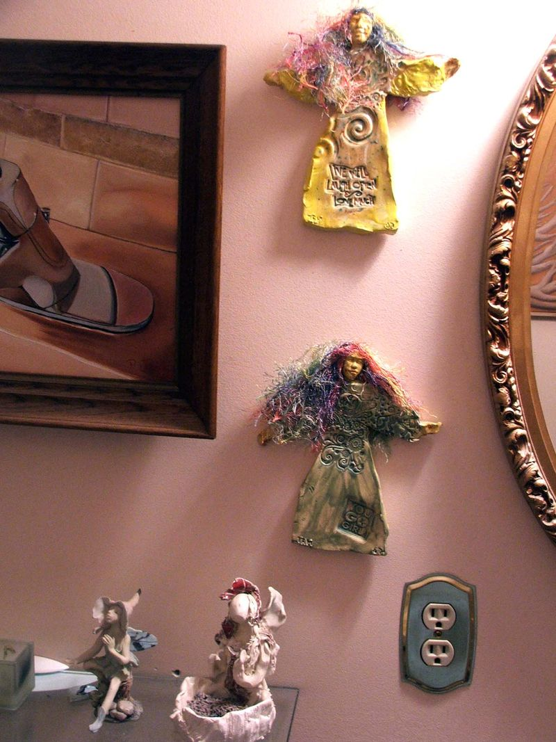 Art in my house bathroom WW and fairy candleholder