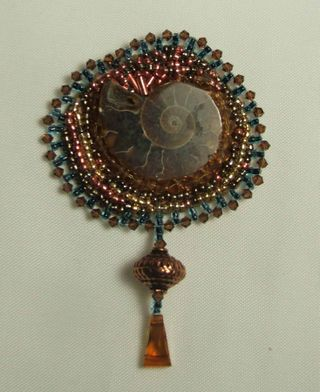 Beadwork amonite with copper and swaovski drop
