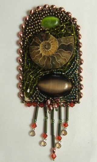 Beadwork focal ammonite and 2 stones